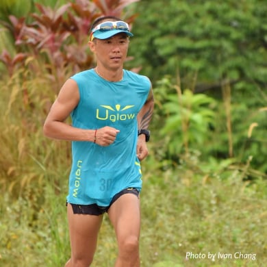 Ultramarathon runner Steven Ong is running in a park.