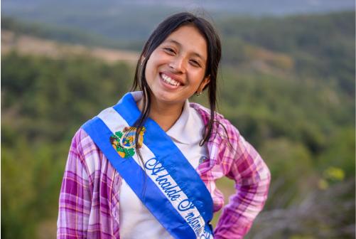 Nahomy smiling wearing her youth mayor sash